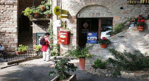 Italy moves to sell stake in post office to cut public debt