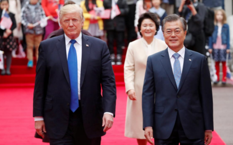 Trump, at North Korea's doorstep, says solution must be found to nuclear standoff